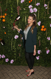 Lo Bosworth was business-chic in a forest-green blazer at the Cosmopolitan and the Art of La Soiree celebration.