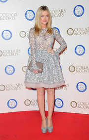 Laura Whitmore elongated her  gams in a pair of powder blue platform pumps.
