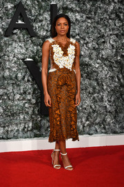 Naomie Harris contrasted her frilly frock with simple white ankle-strap heels.