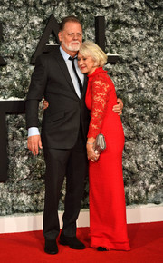 Helen Mirren chose a red Jacques Azagury gown with lace sleeves for the European premiere of 'Collateral Beauty.'