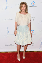 Kathy Hilton completed her demure look with an embroidered baby-blue skirt.