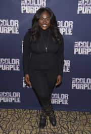 Danielle Brooks wrapped up her curves in a tight-fitting black turtleneck for the 'Color Purple' Broadway cast photocall.