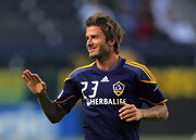 Beckham doesn't let his shaggy long hair get in the way of his play on the field.