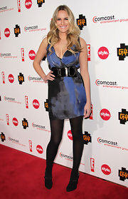 Ashlan dons an iridescent blue cocktail dress with a large leather belt.