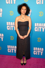 Ilana Glazer styled her dress with elegant black Mary Janes.