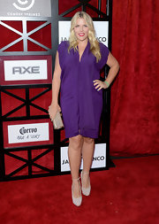 Busy Philipps chose a draped mini dress in a rich grape he for her red carpet look at the roast of James Franco.