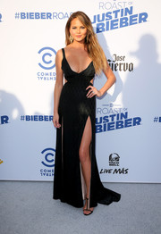 Chrissy Teigen was a scene stealer in a black Temperley London gown with waist cutouts, two hip-high slits, and a plunging neckline during the Comedy Central Roast of Justin Bieber.