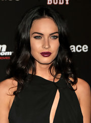 Megan Fox looked sultry in dramatic dark plum lipstick.