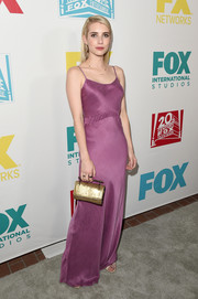 Emma Roberts polished off her elegant ensemble with a metallic gold purse by M2Malletier.