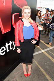 Abigail Breslin played with colors with this red Eleven Paris leather jacket and blue blouse combo during Comic-Con.