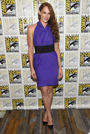 Amanda Righetti was classic and sexy in a purple halter dress with a black waistband during Comic-Con International 2016.