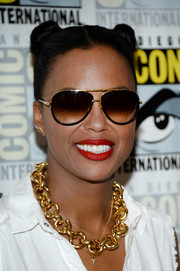 Aisha Tyler kept her aviators on while posing on the Comic-Con red carpet.
