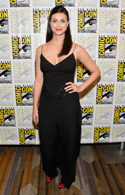 Morena Baccarin matched her top with a pair of baggy black pants.