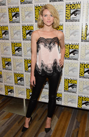 Erin Richards contrasted her delicate top with edgy black leather pants.