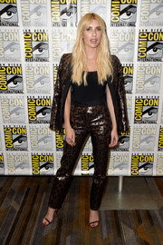 Emma Roberts walked on the wild side in a shiny leopard-print pantsuit by Mulberry during Comic-Con International 2016.