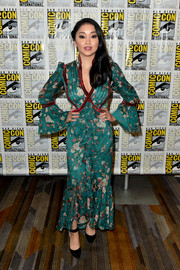 Lana Condor paired her frock with black ankle-strap pumps.