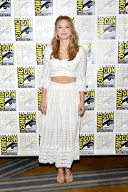 Melissa Benoist styled her white separates with strappy gold heels.