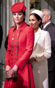Kate Middleton teamed a nude suede clutch by Emmy London with a chic red coat for a Commonwealth Day service.
