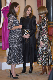 Stella McCartney paired a long-sleeve black midi dress with pointy boots for the Commonwealth Fashion Exchange Reception.