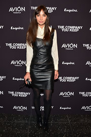 Rebecca Dayan paired a sleek leather dress over a sheer and light button down for an interesting blend of textures.