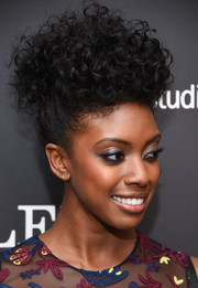 Condola Rashad looked fabulous at the New York premiere of 'Complete Unknown' wearing this curly updo.