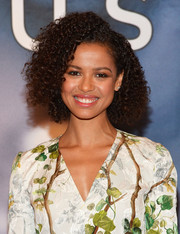 Gugu Mbatha-Raw rocked a voluminous curly hairstyle at the 'Concussion' photocall in NYC.