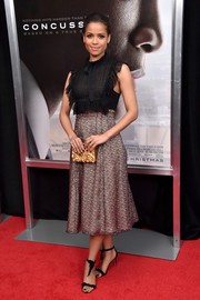 Gugu Mbatha-Raw was sweet and ladylike at the New York premiere of 'Concussion' in a Philosophy di Lorenzo Serafini cocktail dress featuring a ruffled bodice and a printed skirt.