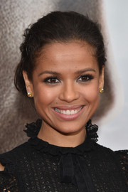 Gugu Mbatha-Raw complemented her updo with classic diamond and gold studs.