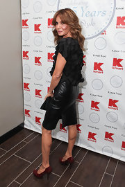 Jaclyn was honored for her amazing style by Conde Nast as she posed in a sexy black leather pencil skirt.