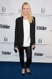 Naomi Watts is known for a more sophisticated look like these leather pants and oversized white shirt.