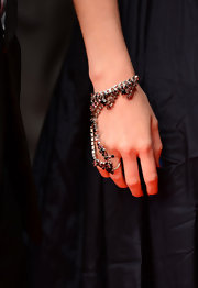 Lily Cole attended the 'Confession of a Child of the Century' premiere wearing a gorgeous gemstone ring-bracelet.