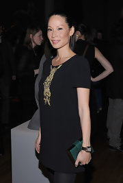 Lucy Liu added a pop of color to her outfit with this green croc-embossed clutch.