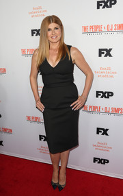 Connie Britton styled her dress with black lace cap-toe pumps.