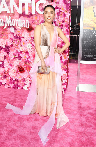 Constance Wu Box Clutch [isnt it romantic,red carpet,clothing,pink,carpet,flooring,dress,fashion model,hairstyle,fashion,beauty,arrivals,constance wu,california,los angeles,the theatre,ace hotel,warner bros. pictures,premiere]