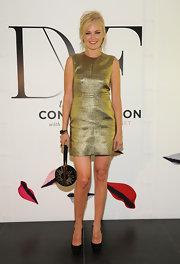 Malin Akerman looked glam in this metallic gold sheath dress at the DVF studio event.