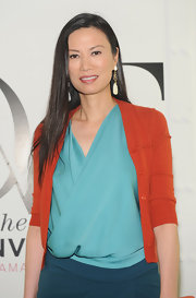 Wendi Deng wore a silk top underneath her knit cardigan at the Conversation series launch by DVF.