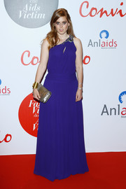 Princess Beatrice made an appearance at the Convivio 2016 photocall wearing a purplish-blue one-shoulder gown by Roberto Cavalli.