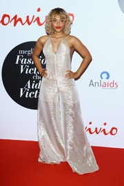Kiersey Clemons was quirky-chic in a metallic halter jumpsuit with extremely wide legs at the Convivio 2016 photocall.