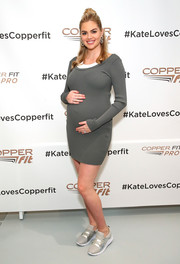 Kate Upton stayed cozy in a gray maternity sweater dress at the Copper Fit launch event.