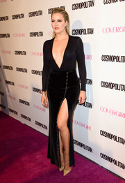 Khloe Kardashian turned heads at Cosmopolitan's 50th birthday celebration in a black American Apparel bodysuit with a navel-grazing neckline.