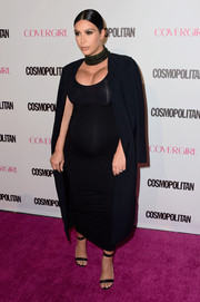 Kim Kardashian attended Cosmopolitan's 50th birthday celebration rocking her signature maternity style: a coat, tight top, and pencil skirt in all black.