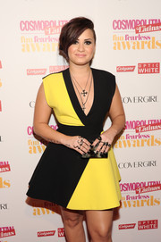 Demi Lovato finished off her look with some edgy statement rings by Lynn Ban.