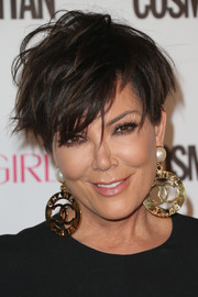Kris Jenner made quite a statement with her huge Chanel pearl and gold doorknocker earrings.