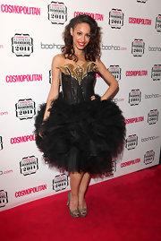 Amelle Berrabah wore a black corset dress with a full tulle skirt for the Cosmopolitan Women of the Year Awards.
