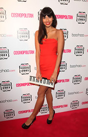 Jamela Jamil topped off her bright orange cocktail dress with metallic platform pumps.