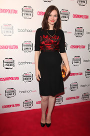 Sophie Ellis-Bextor added shine to her slightly subdued red carpet style with a brassy frame clutch.