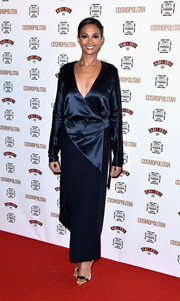 Alesha Dixon chose a plunging navy wrap dress for her Cosmopolitan Ultimate Women of the Year Awards look.