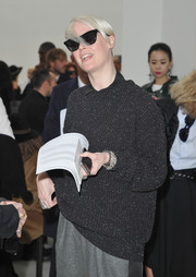 Kate Lanphear attended the Costume National fashion show wearing a baggy black crewneck sweater.