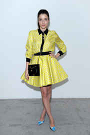Eleonora Carisi made clashing prints look so stylish when she wore these blue and silver pumps with her yellow dress.