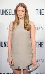Cara Theobold glammed up her plain dress with an elegant silver sequined clutch when she attended the screening of 'The Counselor.'